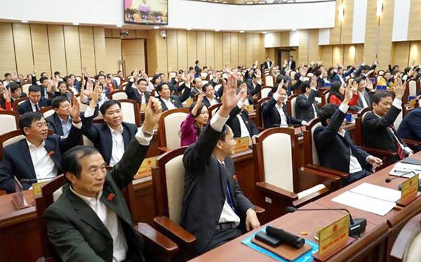 Hội đồng nhân dân thành phố Hà Nội thông qua 16 nghị quyết - Ảnh 1.