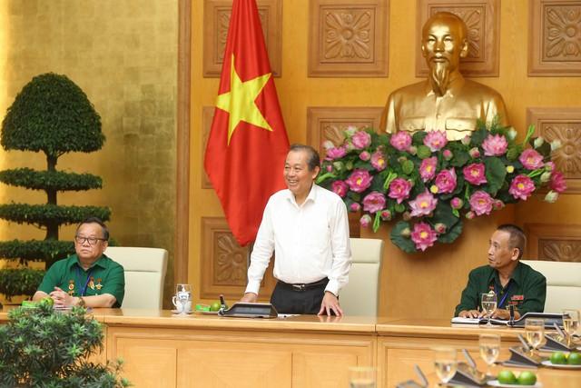 Phó Thủ tướng Thường trực tiếp đoàn cựu TNXP giao vận Quảng Đà - Ảnh 1.